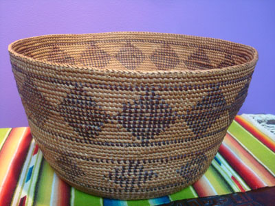 Native American Indian antique baskets, and Yokuts baskets, a very fine Yokuts basket with a fine gap-stitch weave and lovely geometric diamonds, Central California, c. 1920.